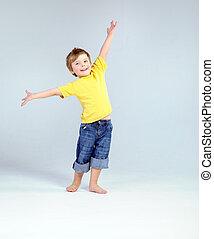 Joyful little boy playing a plane