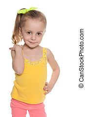 Joyful little girl against the white