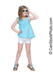 Joyful little girl in a polka dot blue dress