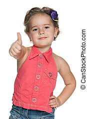 Joyful little girl in red with her thumb up