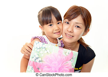 Joyful little girl with present