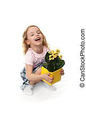 Joyful little girl with yellow flowers.