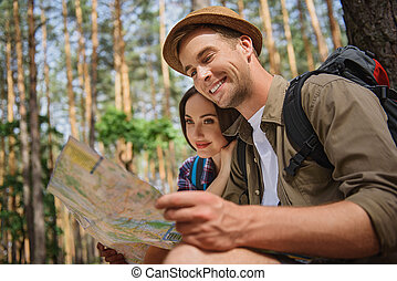 Joyful loving couple relaxing in nature