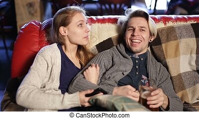 Joyful loving couple spending leisure in cafe