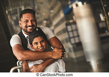 Joyful loving father embracing his little son