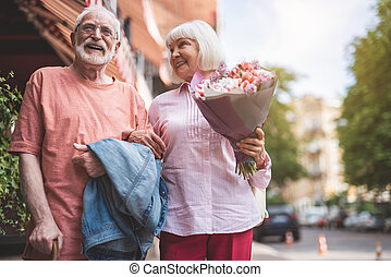 Joyful male and female spending time with pleasure
