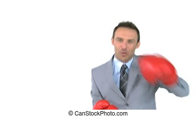 Joyful man giving punches with boxing gloves in front of the camera