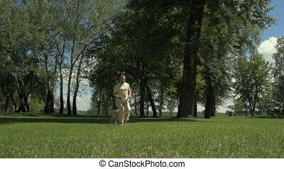 Joyful man playing with his dog