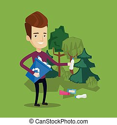Man collecting garbage in forest. - Joyful man with...