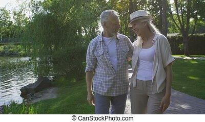 Joyful mature couple taking a stroll in nature - Joyful...