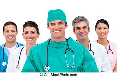 Joyful medical team standing against a white background