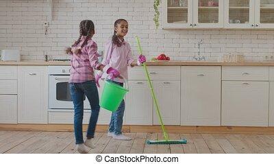 Joyful mixed race kids having fun during cleaning - Carefree...