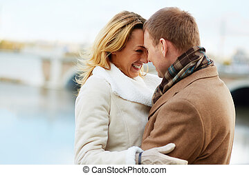 Joyful moment - Portrait of affectionate couple standing ...