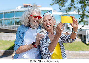 Cheerful positive woman taking a selfie