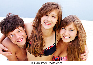 Joyful mood - Portrait of happy teenage guy and two pretty...