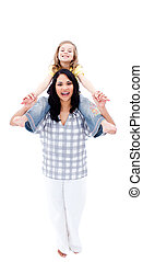 Joyful mother giving her daughter piggyback ride