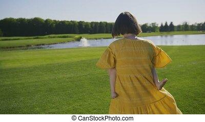 Joyful mother spinning speial needs girl in park - Cheerful...
