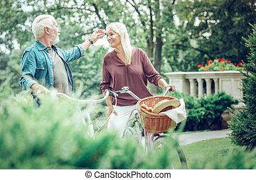 Joyful nice man touching his wifes face