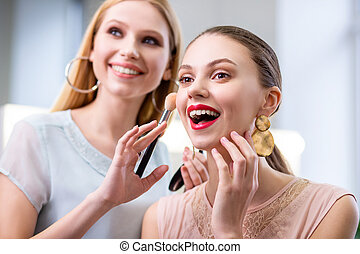 Joyful nice woman feeling excited about her makeup