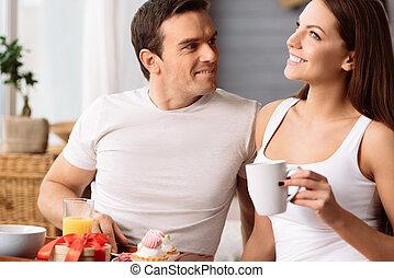 Joyful nice woman having fun with her boyfriend