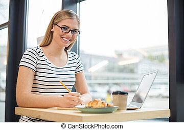 Joyful nice woman having lunch