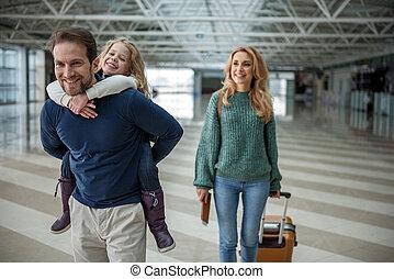 Joyful passengers going on board - Smiling family of ...