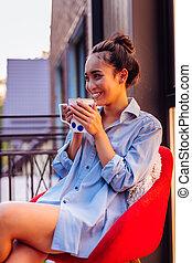 Joyful positive Asian woman enjoying her morning