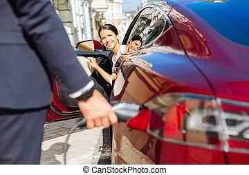 Joyful positive businesswoman looking at her business partner