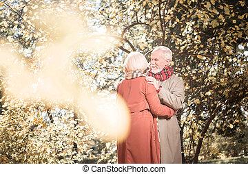 Joyful positive elderly people meeting in the park