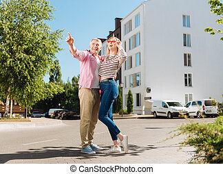 Joyful positive man pointing with his finger
