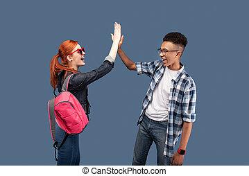 Joyful positive people greeting each other