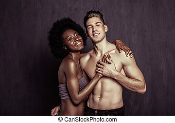 Joyful positive woman putting her hand on boyfriends chest