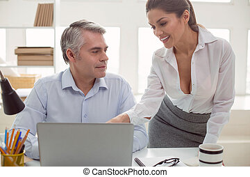 Joyful positive woman smiling to her colleague