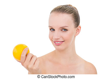 Joyful pretty blonde model holding an orange