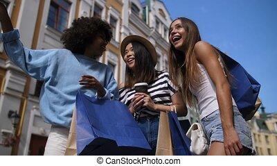 Joyful pretty girls enjyoing time together outdoors