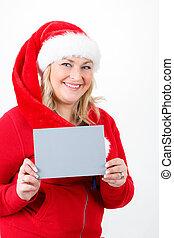 joyful pretty santa woman with empty sign