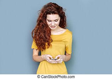 Joyful pretty woman talking with her friends