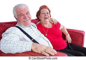 Joyful relaxed elderly couple