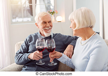 Joyful senior couple celebrating their wedding anniversary