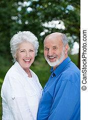 Joyful senior couple enjoying nature