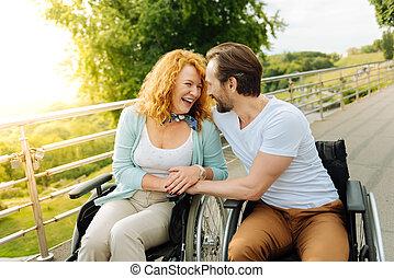 Joyful senior couple resting in the park
