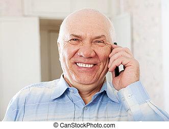 joyful senior man speaking by mobile - Portrait of joyful...