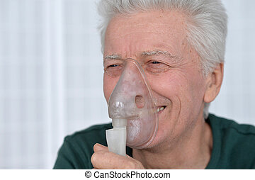 Joyful Senior man with inhaler