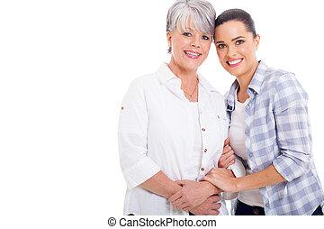 joyful senior mother and young adult daughter