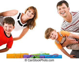 Joyful shoppers - Image of cheerful family members standing ...
