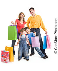 Joyful shopping - Image of cheerful family members standing...