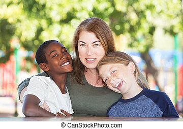 Joyful single parent with sons at park table