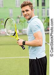 Joyful sportsman ready to play