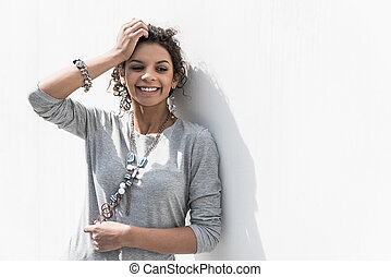 Joyful stylish teenager is enjoying sunny day