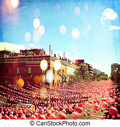 Joyful summer street in gay neighborhood decorated with pink balls